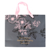 Christian Art Gifts, Proverbs 31:25 Large Floral Gift Bag, Pink & Black, 10 x 12 5/8 x 4 1/4 inches